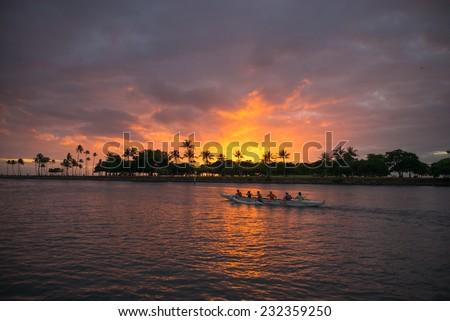 Description:  Honolulu, Hawaii. November 21, 2014, Outrigger Canoe racing at sunset, Honolulu, Hawaii, November 21, 2014. - stock photo
