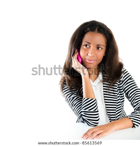 Description Teenage girl on a pink cell phone listening and looking interested - stock photo