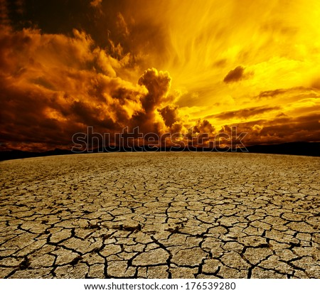 Desert and cloudy sky scenery. Dry soil and storm landscape - stock photo