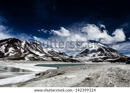 Desert and mountain over blue sky and white clouds on Altiplano,Bolivia - stock photo