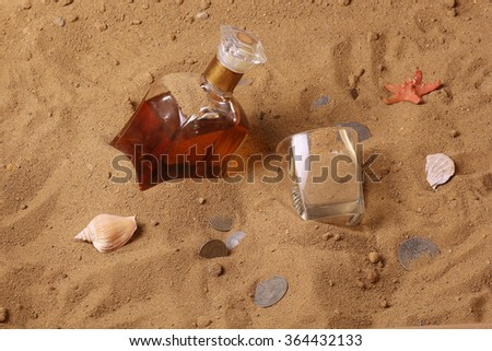 Desert bottle of whiskey and old coins