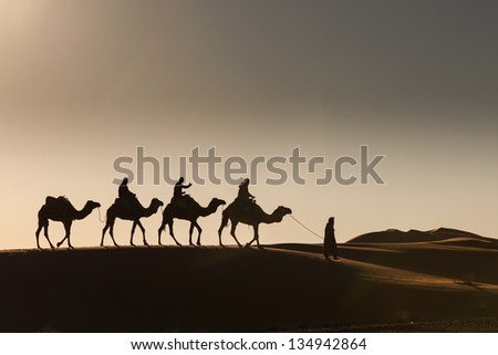 Desert, Camel Ride, Enjoying and happy People - stock photo