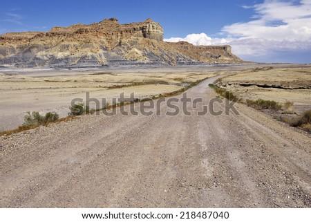 Desert dirt road in Glen Canyon National Recreation Area. - stock photo