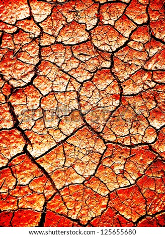 Desert dirt that is dry and cracked - stock photo