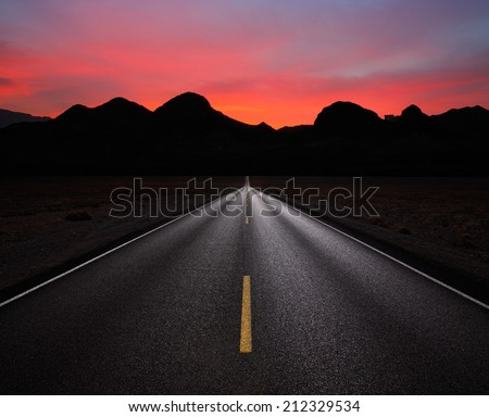 Desert Highway And Mountains At Sunrise Near Lake Mead And The Nevada - Arizona Border, USA - stock photo