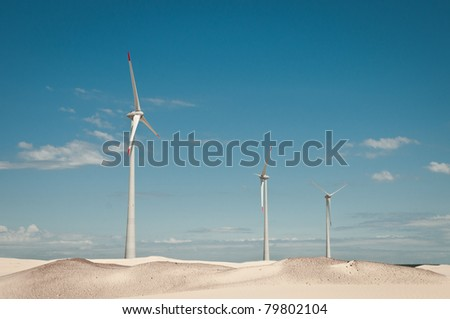 Desert Hillside of White Wind Turbines