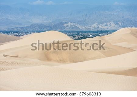Desert in Huacachina, Peru. Dunes in background - stock photo