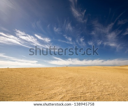 desert landscape, dunes, sky in the background - stock photo
