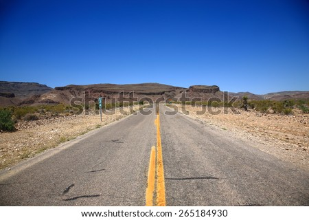 Desert Landscape - Road heads into the Black Mountains of Arizona in the American Southwest.  - stock photo