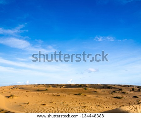 Desert landscape with blue sky - stock photo