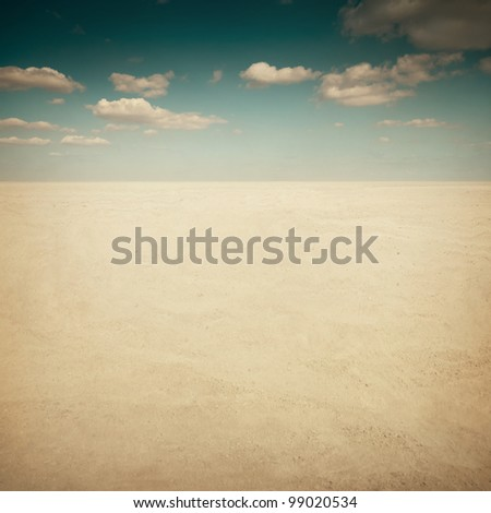 Desert landscape with clouds - stock photo