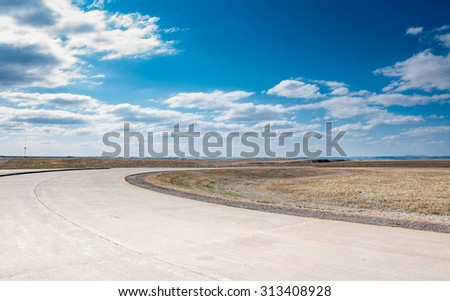 Desert landscape with curvy road, South Dakota, USA in the day light  - stock photo