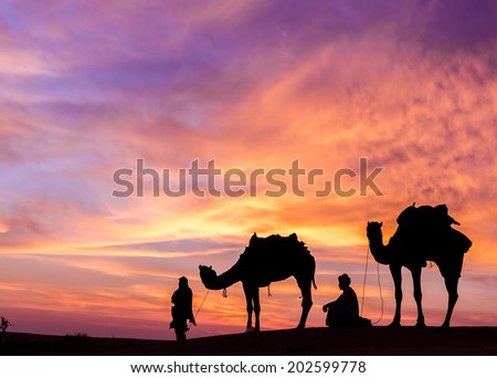 desert man with camel and great sky settings. - stock photo