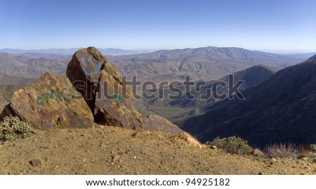 Desert mountain landscape with graffiti on rocks