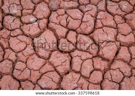 Desert red dry and thirsty soil crack background - stock photo