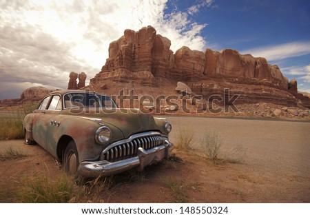Desert Relic/Old Car rusting away in the desert - stock photo