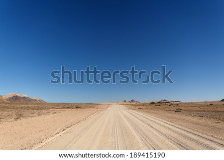 Desert Road at Sossusvlei in the Namib Desert, Namibia, Africa - stock photo