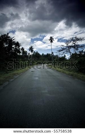desert road during a rainstorm in zanzibar - stock photo