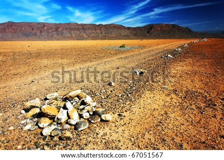 Desert road in Middle Atlas Mountains, Morocco, Africa - stock photo