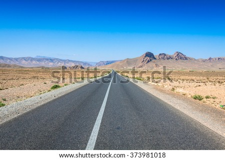 Desert road in Morocco - stock photo