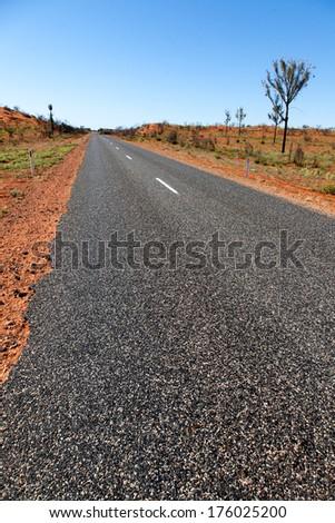 desert road in outback australia near Alice springs - stock photo