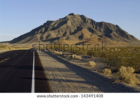 Desert road. Shows Eagle Mountain in the background  and Highway 127, California, USA. On Hwy 127, south of Death Valley Junction. - stock photo
