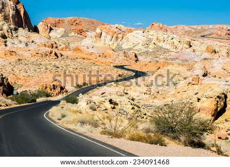 Desert road trip and Solitude. View of Valley of Fire artists pallet road, and colorful sandstone formations - stock photo
