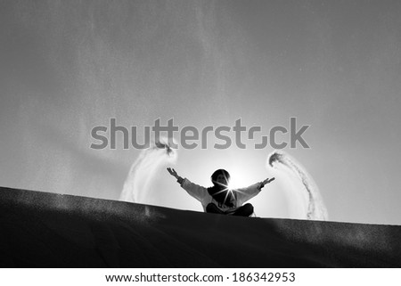 DESERT SAHARA, MOROCCO - MARCH 4: Unidentified person throwing with sands on March 4, 2014. Desert Sahara is the world's hottest desert, and the third largest desert in Morocco.
