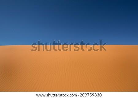 desert sand against the blue sky  - stock photo