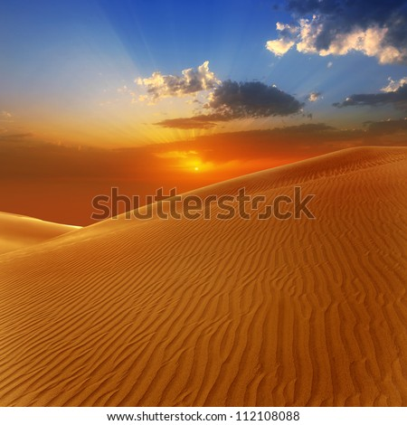 Desert sand dunes in Maspalomas sunset Gran Canaria at Canary islands [Photo illustration] - stock photo