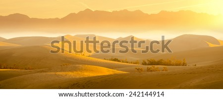 Desert Sand Dunes with Beautiful Mountain View in the Background - stock photo