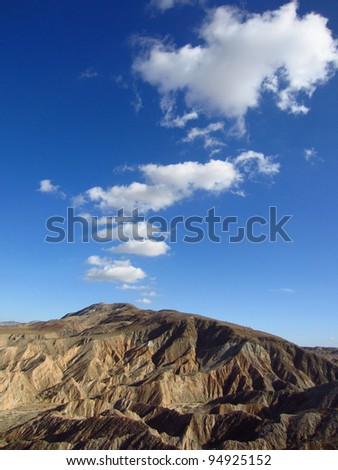 Desert slot canyon badlands with emerging cloud formation