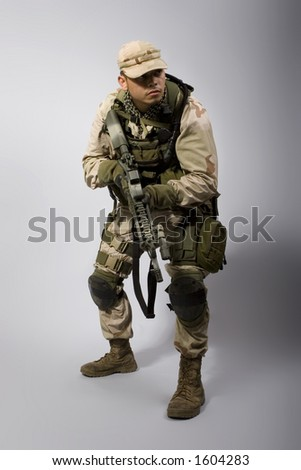desert storm soldier in the army dressed in camo standing up - stock photo