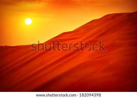 Desert sunset landscape, hot dry wilderness, beautiful panoramic scene, sandy orange hills, extreme travel, heat concept - stock photo