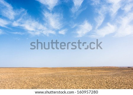 desert under blue sky with clouds,china