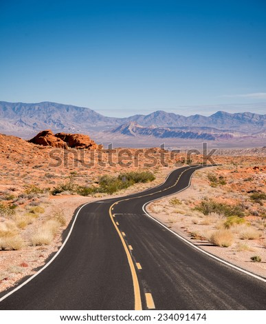 Desert View from a isolated road. Desert road trip and Solitude - stock photo