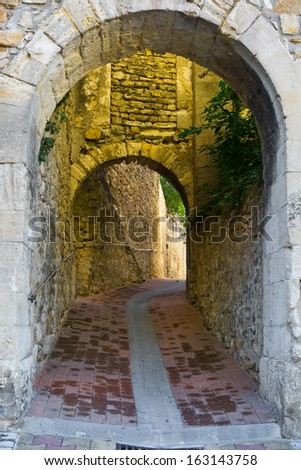 Deserted Archway in the Medieval  French City  - stock photo