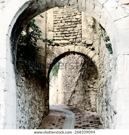 Deserted Archway in the Medieval  French City, Vintage Style Toned Picture  - stock photo