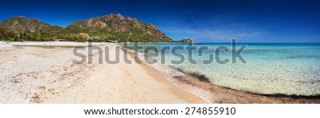 Deserted beach with clear blue sea - stock photo