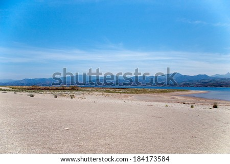 Deserted beach with mountains at background, Tindari gulf, Sicily, Italy