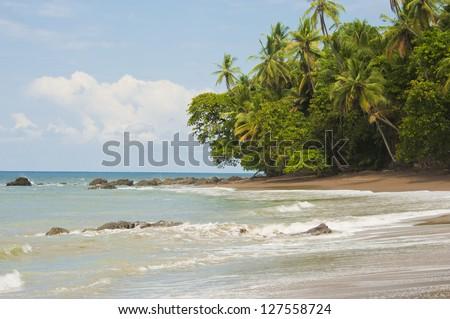 Deserted beautiful beach at Drake Bay in Costa Rica. - stock photo