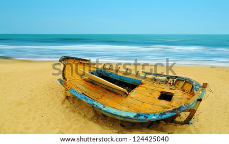 Deserted boat on a beach in Hammamet, Tunisia