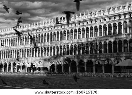 Deserted cafe in Piazza San Marco, Venice (Dramatic black-and-white photo)