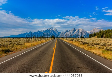 Deserted highway to the Tetons