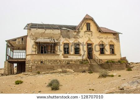 Deserted house near Luderitz Namibia - stock photo