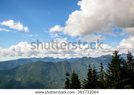 deserted landscape of a mountain chain covered of forests of pines trees close to vancouver city in the rockies of british columbia