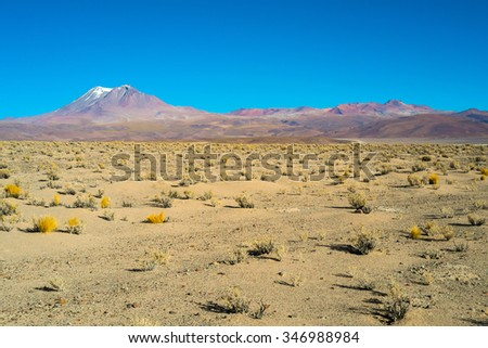 Deserted landscape with volcanoes in Ollague, border between Bolivia and Chile