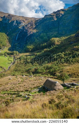 Deserted Old Farmhouse Overlooking Beautiful Valley - stock photo