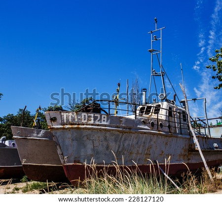 Deserted rusty ship on the coast - stock photo
