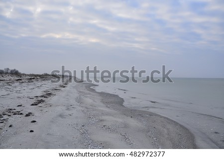 deserted sandy beach, gray color, nobody, calm, late autumn. Soothe and relax. Natural beautiful calm seascape.